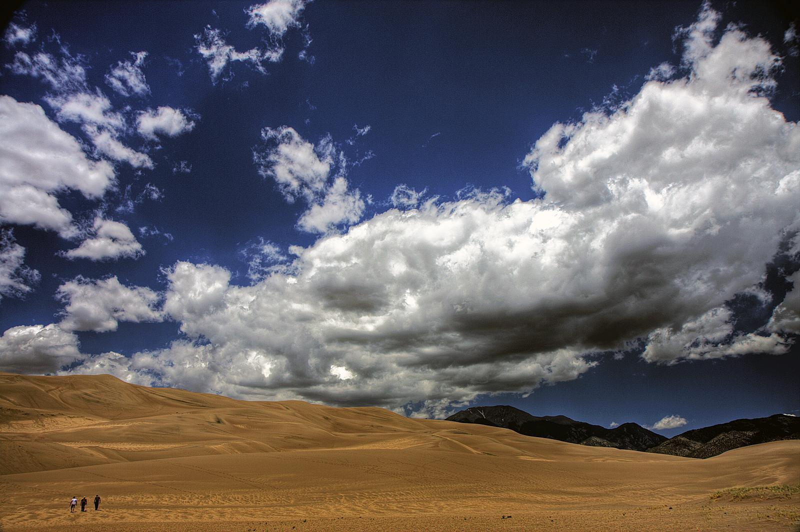 Clouds above sand dunes