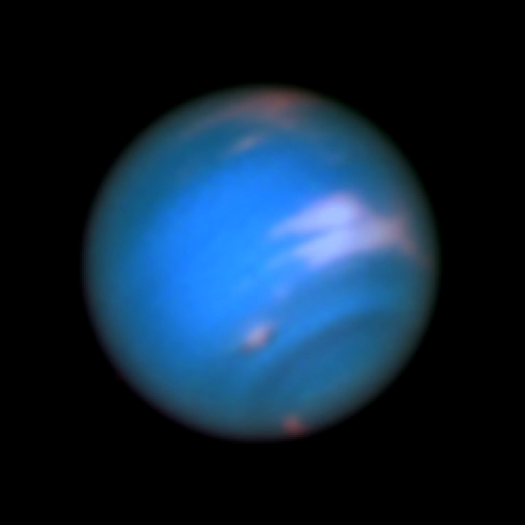 White Methane clouds on Neptune.